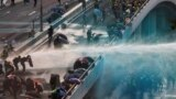 Hong Kong -- Anti-government protesters are sprayed with water cannon by the riot police during a demonstration near Central Government Complex in Hong Kong, China, September 15, 2019