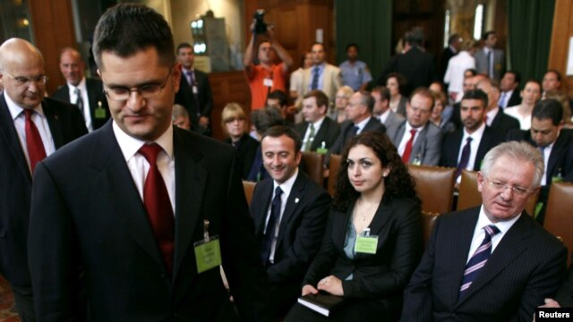 Serbia's Foreign Minister Vuk Jeremic (second from the left) arrives at the International Court of Justice at the Peace Palace in The Hague as Kosovo's Foreign Minister Skender Hyseni (right) looks on July 22.
