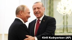 TURKEY -- Turkey's President Recep Tayyip Erdogan, right, and Russia's President Vladimir Putin, greets each other in Tehran, Iran, prior to their talks as part of Russia-Iran-Turkey summit to discuss Syria, Friday Sept. 7, 2018.