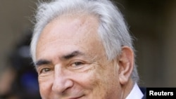Dominique Strauss-Kahn leaves the hearing at the New York State Supreme Courthouse