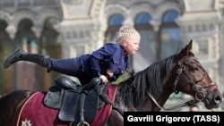 A young girl competes in the children's trick and fancy riding competition at the 2019 Spasskaya Tower International Military Music Festival and Tattoo in Red Square, Moscow. (TASS/Gavriil Grigorov)