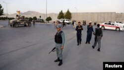 Afghan policemen arrive at the site of a deadly blast in Kabul, Afghanistan, on July 15.