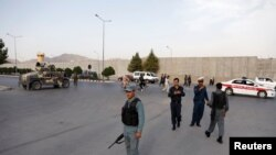 Afghan policemen arrive near the site of a blast in Kabul on July 15.