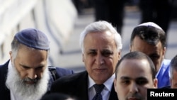Former Israeli President Moshe Katsav (center) is surrounded by lawyers and relatives as he arrives at a district court for his sentencing in March.