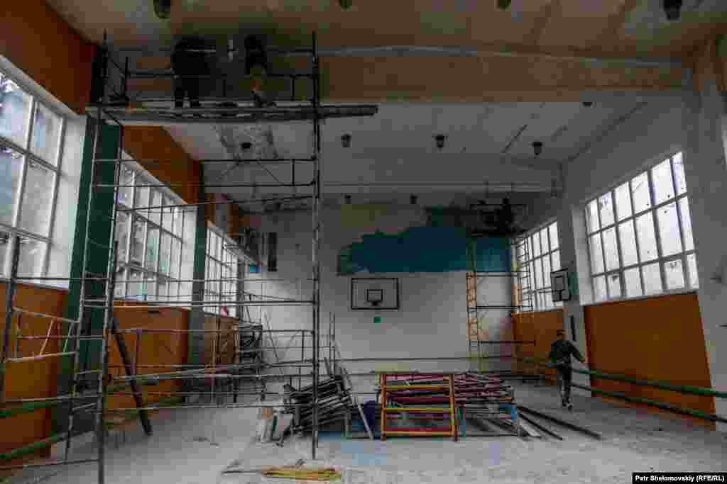 Restoration work is under way at this school gym.