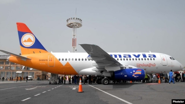 Armenia - Passengers board an Armavia airline flight at Yerevan's Zvartnots airport.