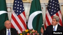 U.S. Secretary of State John Kerry (right) and Pakistan's national security and foreign affairs adviser, Sartaj Aziz, deliver opening remarks at a ministerial-level meeting at the State Department in Washington on January 27.