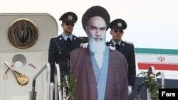 A cardboard Ayatollah Ruhollah Khomeini arrives in Tehran to mark the 33rd anniversary of his triumphant return to Iran following the Islamic Revolution.