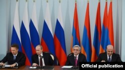 Armenia - Energy Minister Armen Movsisian (R) and Gazprom Chairman Alexei Miller (L) sign a Russian-Armenian gas deal in the presence of Presidents Vladimir Putin and Serzh Sarkisian, Yerevan, 2Dec2013.