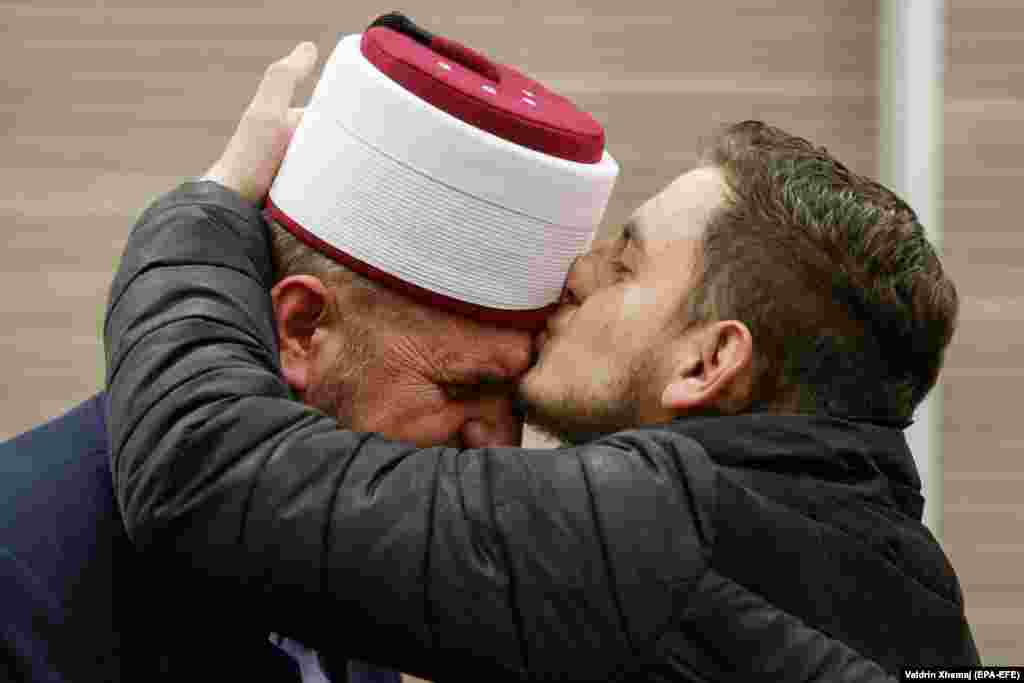 A supporter kisses imam Shefqet Krasniqi (left) after he was acquitted in a Kosovar court after being accused of terror and hate speech. Kosovo, with its 1.8-million predominantly Muslim population, has been a major source of foreign fighters, with some 350 joining extremist groups in Syria and Iraq. (epa-EFE/Valdrin Xhemaj)