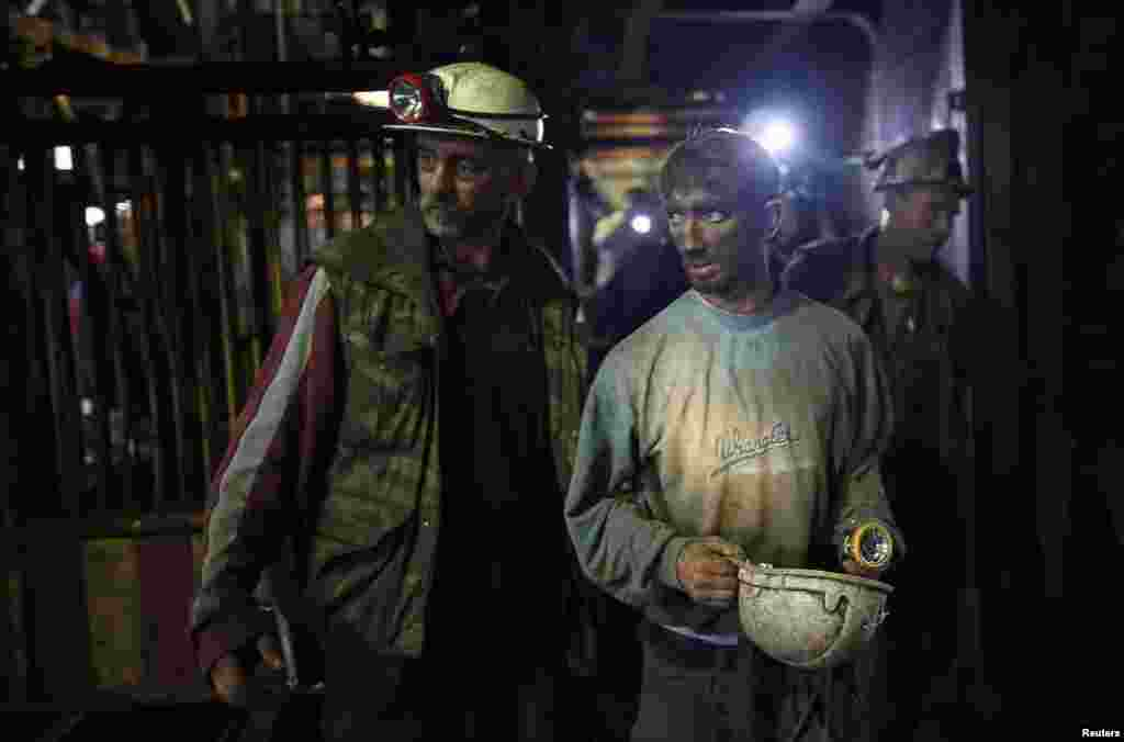 An injured coal miner leaves after he was trapped inside a coal mine in Zenica, Bosnia-Herzegovina, on September 5. Five miners died in the mine following an earthquake. Twenty-nine miners who were trapped were rescued.