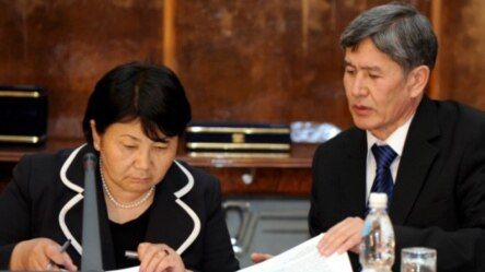 President Roza Otunbaeva (left) headed Kyrgyzstan's interim government before being succeeded by Almazbek Atambaev (right). (file photo)