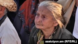 """Grandma Leyla"" (Vranouhie Gevorgyan) attends a protest rally in Yerevan in April 2018."