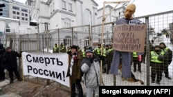 "A mannequin depicting Russian President Vladimir Putin is hung on a gallows with a sign reading ""Death to Putin, death to the rascist occupier"" during a rally outside the Russian Consulate in Kyiv on March 18."