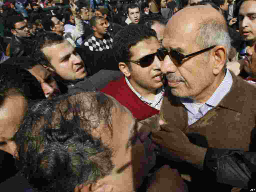Muhammad El-Baradei is surrounded by demonstrators in Cairo on January 28.