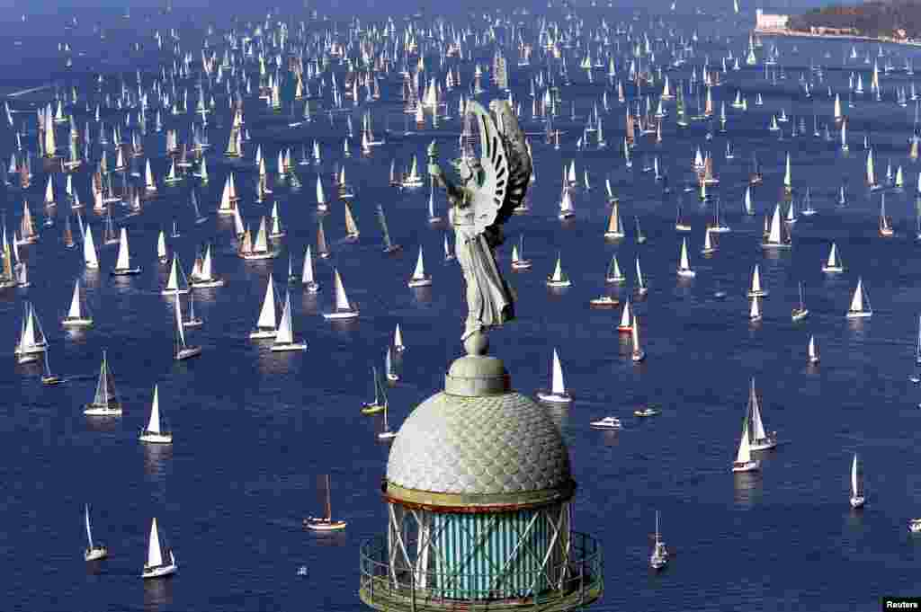 Sailing boats gather at the start of the Barcolana regatta in front of Trieste harbor, Italy, on October 9. (Reuters/Stefano Rellandini)