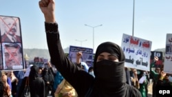 FILE: Afghanistan activists protest against the former warlords and communist regimes of the 1980s and 1990s.