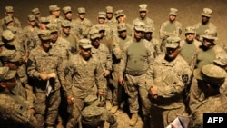 U.S. soldiers listen to a briefing on August 19 before their unit leaves Iraq.