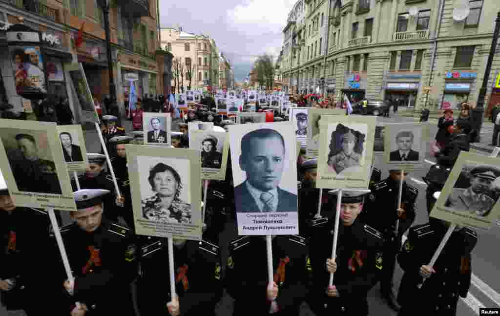 Russian cadets whose relatives fought in World War Two carry their portraits during a parade in St. Petersburg on May 5. (Reuters/Alexander Demianchuk)