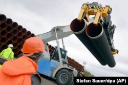 Steel pipes for the Nord Stream 2 pipeline are uploaded in Mukran harbor in Sassnitz, Germany.