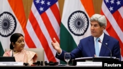 India - U.S. Secretary of State John Kerry (R) gestures as India's External Affairs Minister Sushma Swaraj looks on during their joint news conference in New Delhi, India, August 30, 2016