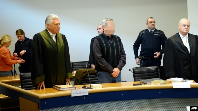 A pixilated picture of Andreas Anschlag (center), who has been accused along with his wife of spying for the Russian secret services in Germany.
