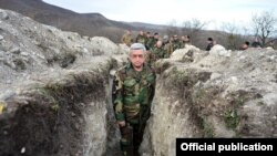 Armenian President Serzh Sarkisian visits a section of the Line of Contact in Nagorno-Karabakh in December.