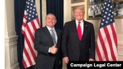 Ukrainian-American businessman Lev Parnas (left) is seen in a 2018 social-media post appearing to show him at the White House with President Donald Trump in a screen capture from his social media account made in 2018 by the Campaign Legal Center.