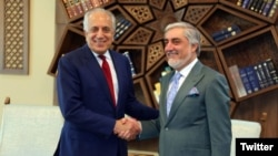 Afghan Chief Executive Officer Abdullah Abdullah (right) meets with Zalmay Khalilzad, the U.S. envoy seeking a peace deal with the Taliban, in Kabul on April 3.
