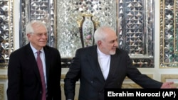 Iranian Foreign Minister Mohammad Javad Zarif, left, welcomes European Union foreign policy chief Josep Borrell, for their meeting in Tehran, February 3, 2020