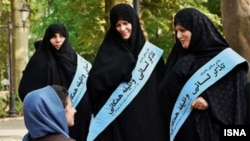 "Female members of Iran's ""morality Police"" on patrol. Undated, File photo"