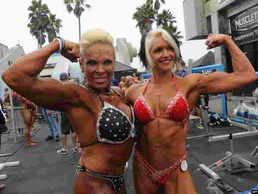 Bodybuilders Lauren Powers (left) and Maire Brandon pose before they compete during the annual Muscle Beach Championship bodybuilding and bikini competition at Venice Beach in Los Angeles on September 6. Photo by Mark Ralston for AFP