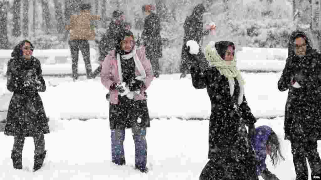 Young people play in the first snow in the city of Rasht, Iran. (IRNA)
