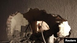 Damage that the LIbyan government said was caused by a NATO-led air strike to the house of Saif al-Arab Qaddafi, son Muammar Qaddafi, in Tripoli