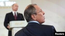 Міністр закордонних справ Росії Сергій Лавров та президент Росії Володимир Путін