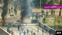 A video TV grab shows clashes in the flashpoint town of Daraa on April 8.