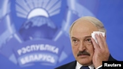 Belarusian President Alyaksandr Lukashenka attends a news conference in Minsk on October 11.