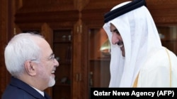 Qatar's Emir Sheikh Tamim bin Hamad Al-Thani (R) greets Iranian Foreign Minister Mohammad Javad Zarif during their meeting in Doha, October 3, 2017