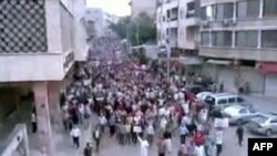 A video grab shows antigovernment protesters marching in Hama on April 29.