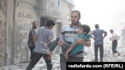 Один из районов в восточной части Алеппо после бомбардировки