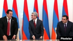 Armenia -- President Serzh Sarkisian (C), Orinats Yerkir Party leader Artur Baghdasarian (R) and Prosperous Armenia Party leader Gagik Tsarukian sign a new coalition agreement, 17Feb2011.