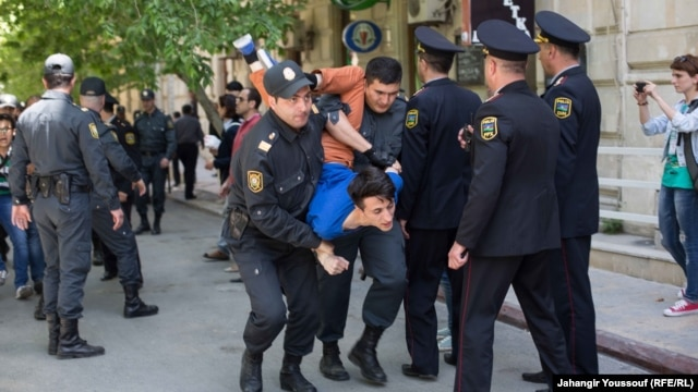 Azerbaijani police arrest protesters following the jailing of youth activists in Baku on May 6.