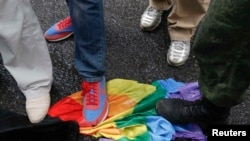 Antigay activists trample on a rainbow flag during a protest by gay-rights activists in Moscow in 2013.