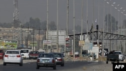 Islamic State militants man a checkpoint in Mosul in June (file photo)