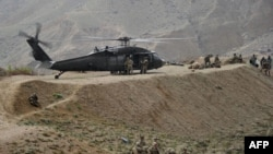 U.S. soldiers are pictured near a UH-60 Black Hawk helicopter during a recovery operation in Nangarhar Province in 2013.