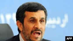 President Mahmud Ahmadinejad (in file photo) was reportedly unhurt and went on to deliver a speech.