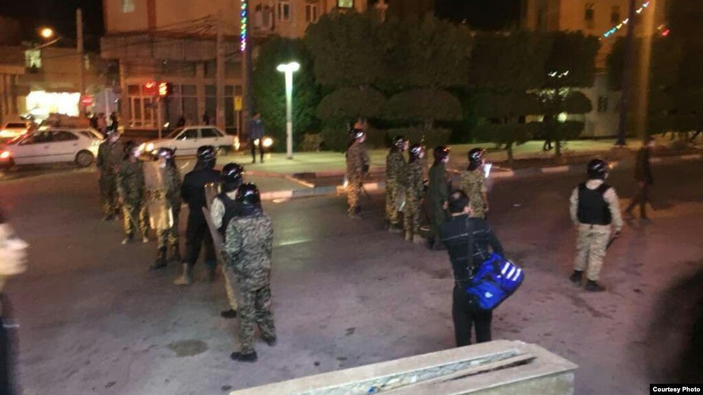 Police gather late on June 30 in the city of Khorramshahr.