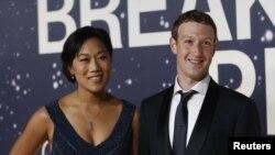 მარკ ზაკერბერგი (მარჯვნივ) და მისი მეუღლე პრისცილა ჩანი. 2014 წლის ფოტო.