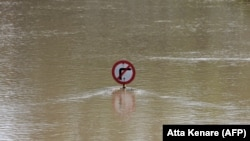 A street sign is seen submerged by water from floods in Ahvaz, the capital of Iran's southwestern province of Khuzestan, April 11, 2019