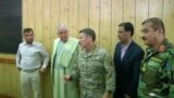 FILE: Police Chief of Kandahar General Abdul Raziq (L), Governor of Kandahar Zalmay Wesa (2nd L) and Commander of NATO forces in Afghanistan U.S. General Scott Miller (C) during the October 18 meeting.